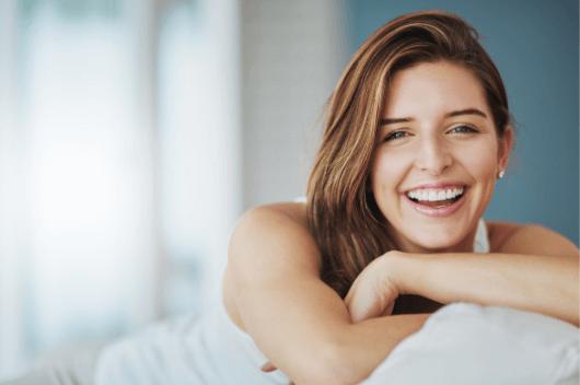 A woman sat smiling